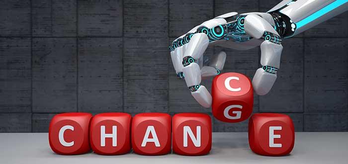 mano_robot_escribiendo_cambio_con_cubos