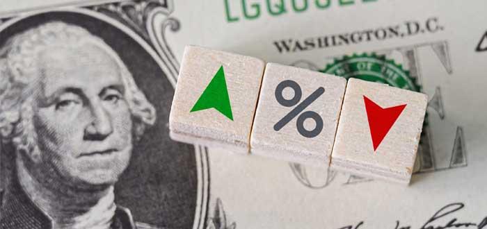 Dólar con ícono porcentual y flechas hacia arriba y abajo
