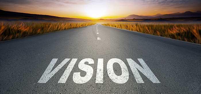 carretera en la que se lee la palabra visión se une con el horizonte